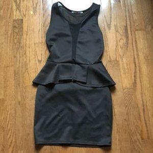 A black Rolla Coster midi dress.